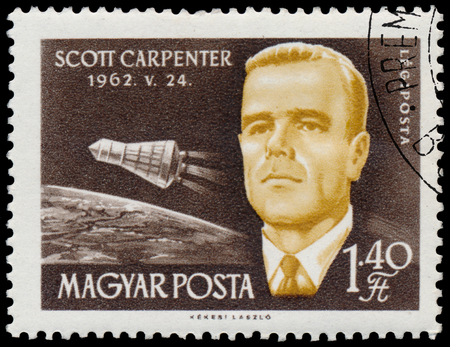 BUDAPEST, HUNGARY - 14 december 2016:  A stamp printed in Hungary shows american astronaut Scott Carpenter; astronauts series circa 1962