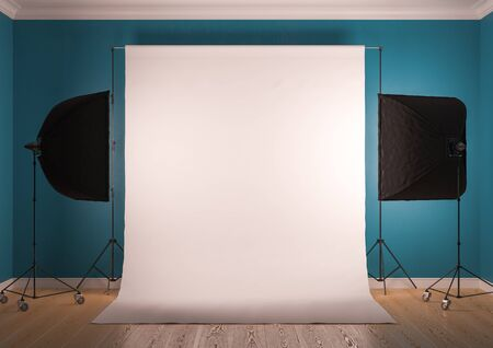 Interior of studio room with equipment. The sky-blue color of the walls. Artificial lighting with softboxes.