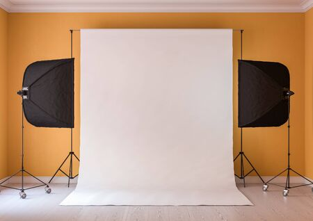 Interior of studio room with equipment. Moderate yellow color of the walls. Lighting from the window. Stock Photo