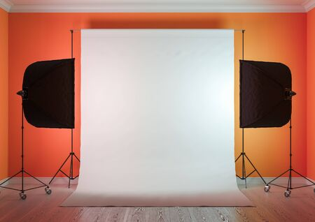 Interior of studio room with equipment. Artificial lighting with softboxes.Salmon-orange color of the walls. 3D rendering