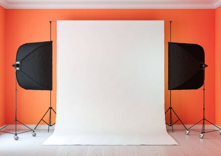 Interior of studio room with equipment. Lighting from the window.Salmon-orange color of the walls.3D rendering