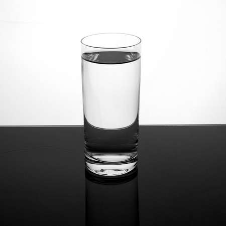 Water in a glass on dark surface