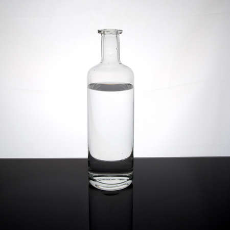 Water in a glass bottle on dark surface