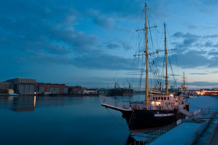 Evening view of the Neva river on a background of yachts, Russia, Saint-Petersburg photo