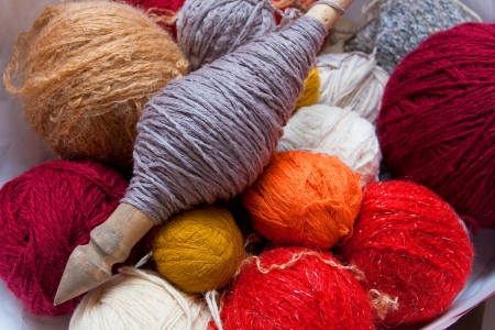 Colorful balls of wool for knitting the spinning wheel