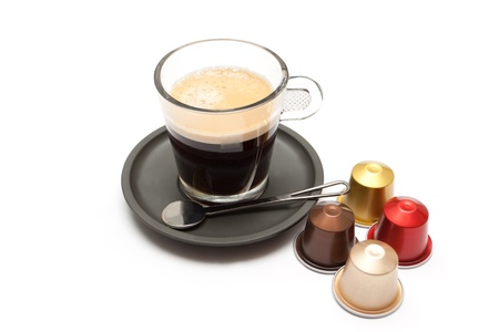 A cup of coffee from the espresso machine with capsules