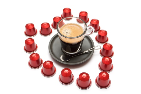 A cup of espresso coffee capsules on a white background in the form of heart Stock Photo