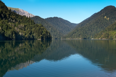 Lake Ritsa located in the northern part of Abkhazia, is a lake in the Caucasus Mountains Stock Photo - 19707794