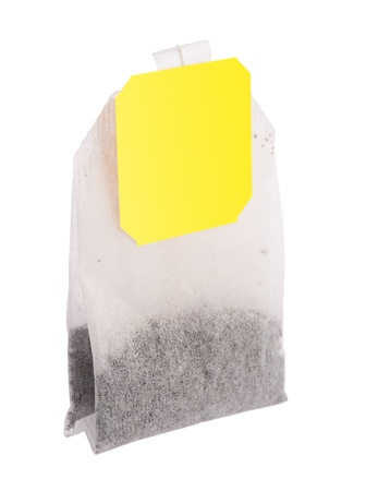 Teabag with yellow label, isolated on white background