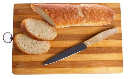 grooved: loaf of bread on a board grooved