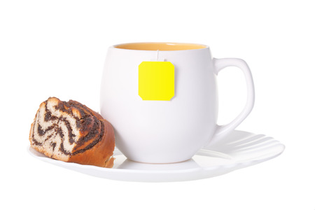 A cup of tea with a cake, on a white background isolated photo