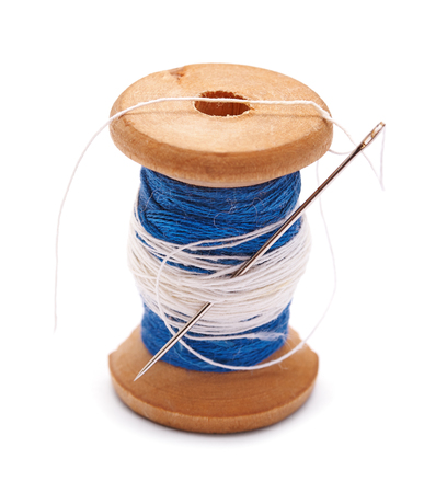 spool of thread on a white background Stock Photo