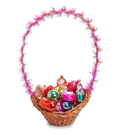 Basket with Christmas toys on a white background, isolated photo