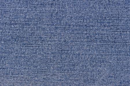 Worn blue denim jeans texture, background, macro Stock Photo