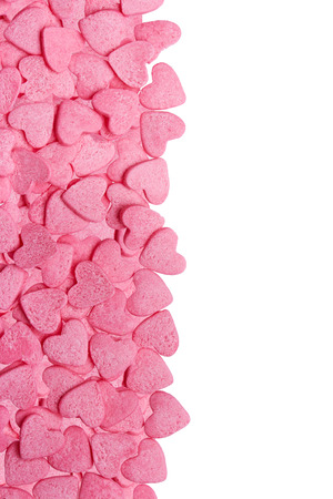 color candy hearts on a pink background photo