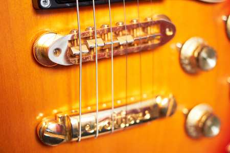 Beautiful Electric Guitar Standing Up Inside, close-up photo