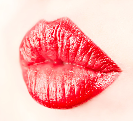 Close-up of lips with lipstick on them on a face, isolated photo
