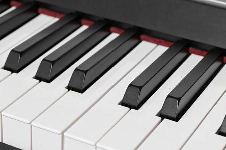 octave: close-up of piano keys, close frontal view