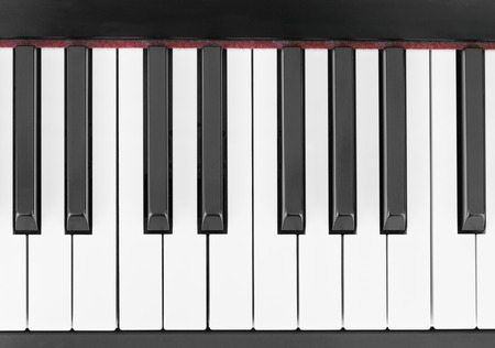 close-up of piano keys, close frontal view photo