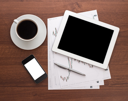 Digital tablet on wooden tablets with mobile and coffee photo