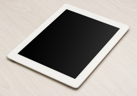 Tablet computer on your desktop bright light photo