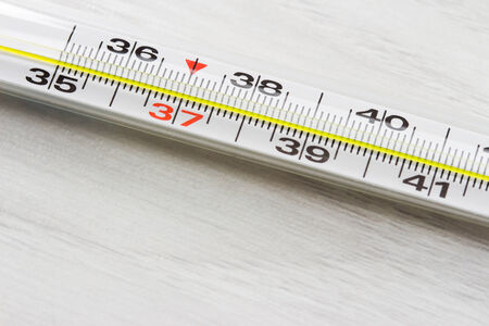 temperature: Thermometer to measure the temperature of the body Stock Photo