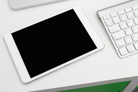 internet keyboard: Tablet PC on a white table with a keyboard and a laptop Stock Photo