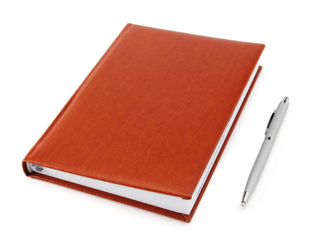 Business diary with a pen on a white background