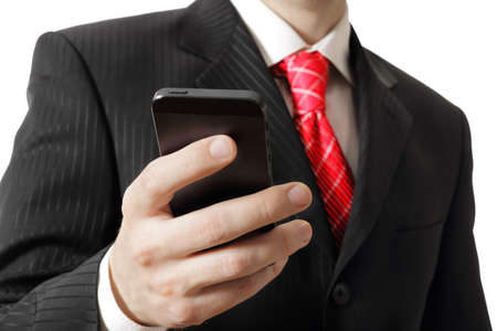 Business man holding a cell phone, close-up photo