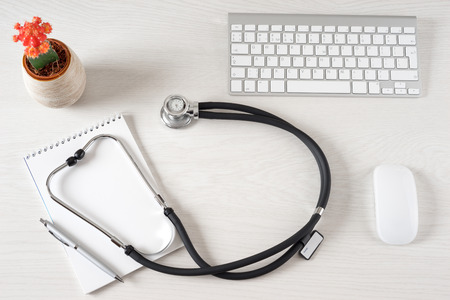 doctors tool: Workplace with notepad and keyboard, and stethoscope