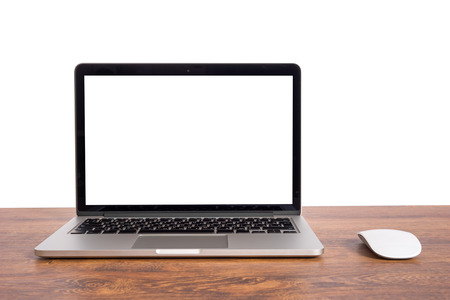 Open laptop with isolated white screen on old wooden desk.