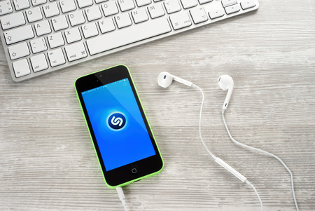 iphone5: Ufa, Russia - April 26, 2016: iPhone 5c Green with music service Shazam on the screen. iPhone 5 was created and developed by the Apple inc. Editorial