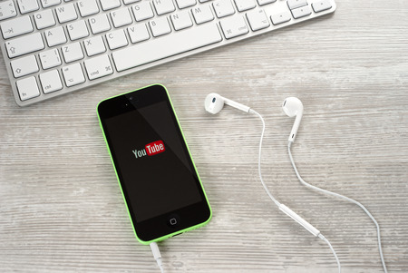 Ufa, Russia - April 26, 2016: iPhone 5c Green with service Youtube on the screen. iPhone 5c was created and developed by the Apple inc.