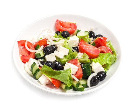 Plate with the salad on a white table , isolate