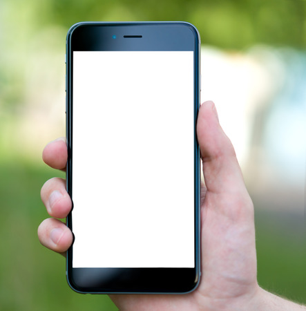 Male hand holding the phone with isolated screen
