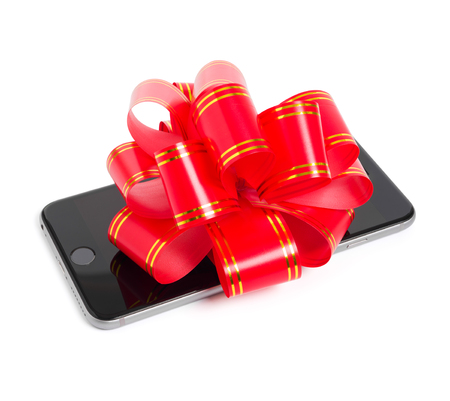 six people: UFA, RUSSIA - JUNE 29, 2015: New iPhone 6 Plus is a smartphone developed by Apple Inc. Phone for gift with red bow.