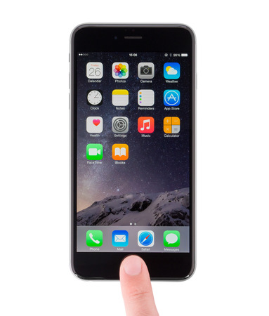 unlocking: UFA, RUSSIA - JUNE 26, 2015: New iPhone 6 Plus is a smartphone developed by Apple Inc. Unlocking your finger.