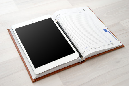 blank tablet: Tablet with blank white screen and coffee cup Stock Photo
