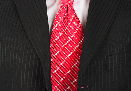 red tie: Suit with a red tie close-up