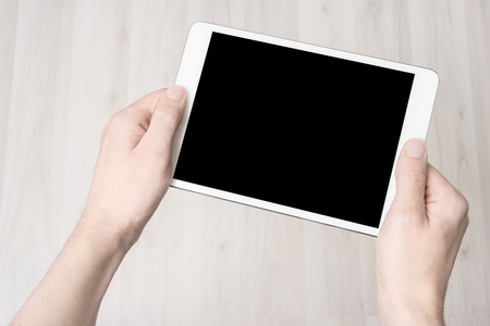 tablet: Digital tablet in hand, on a white background, isolated