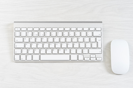 computer isolated: White computer mouse on the keyboard Stock Photo