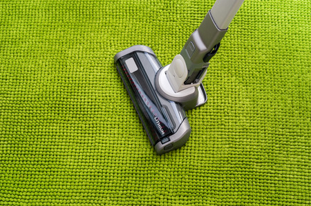 Vacuum cleaner on the floor showing house cleaning Stock Photo