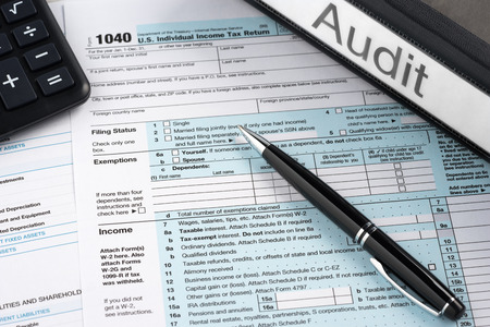 Folder label audit on the table with the tax form