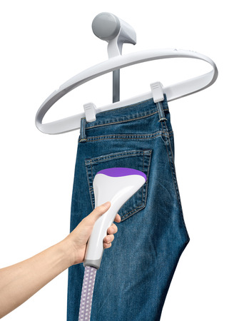 valet: Crumpled jeans hang on the hanger vertical steam, isolated