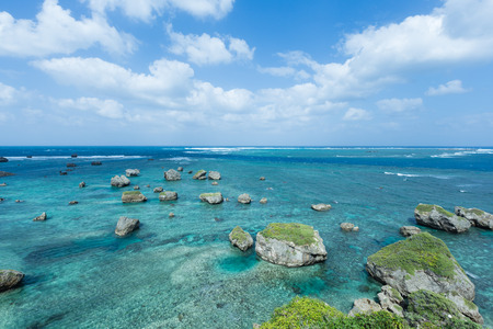 japan sky: Idyllic tropical rocky lagoon full of healthy coral and clear blue water