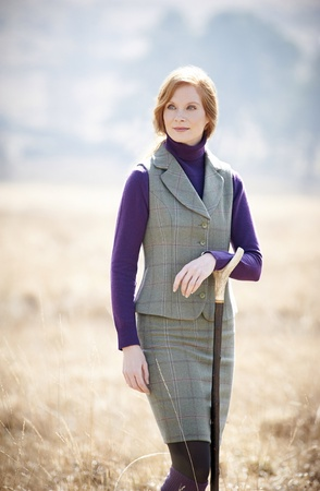 clothes: Redhead model in countryside wearing tweed twinset Stock Photo