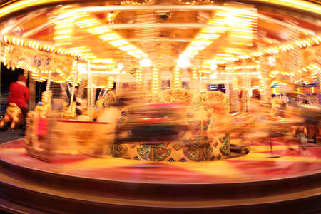 compostion: Slow movement of a carousel ride at a fair. Stock Photo