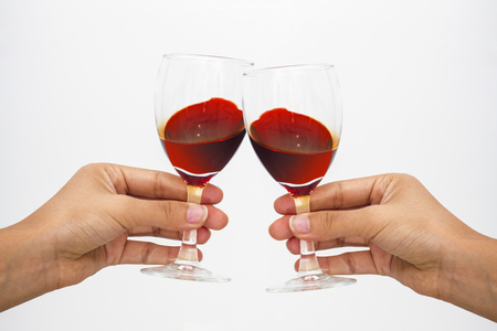 holding red wine cup to make a toast