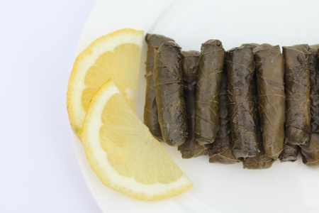 lebanese food: Vine Leaves stuffed with meat and rice with lemon