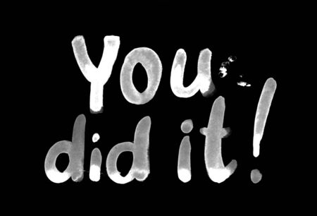 You did it white watercolor lettering drawn in chalk on a chalk board.